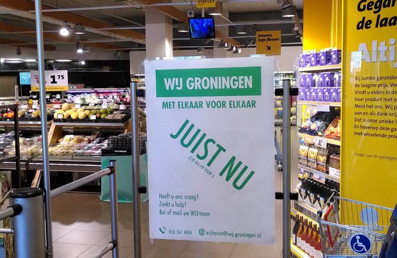 Poster bij ingang supermarkt